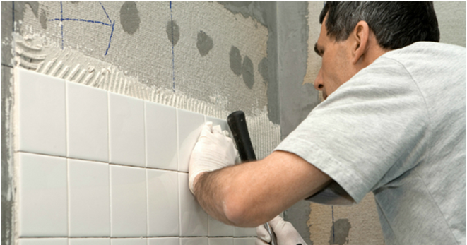 Bathroom Renovator Fixing Tiles